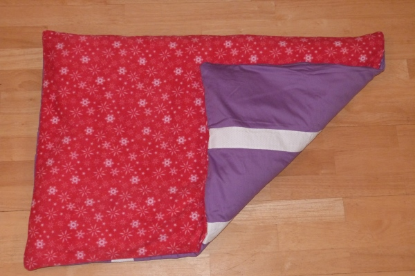 red snowflakes dog bed showing non slip backing