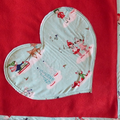dog blanket for christmas showing red heart