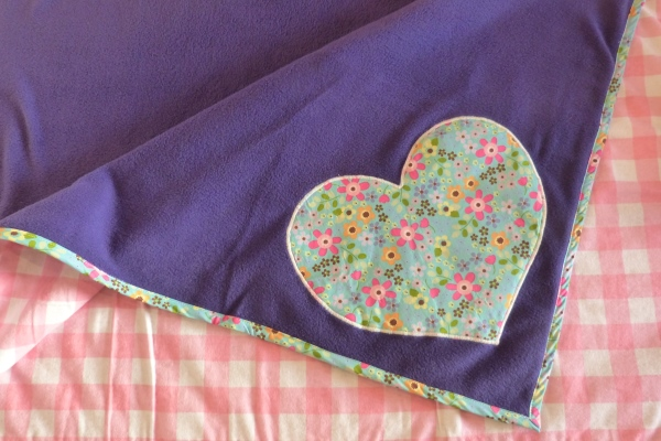 dog blanket in purple fleece with turquoise floral trim