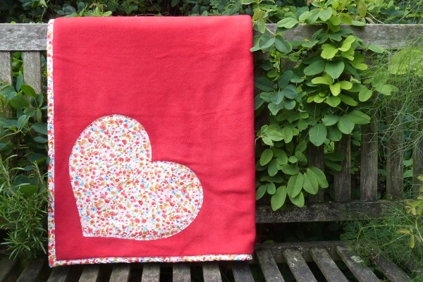 dog blanket in red fleece with coral floral